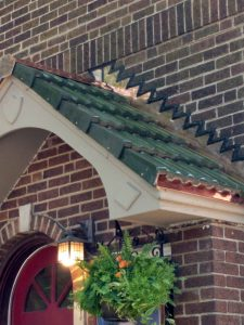 Tile porch roof with copper flashings